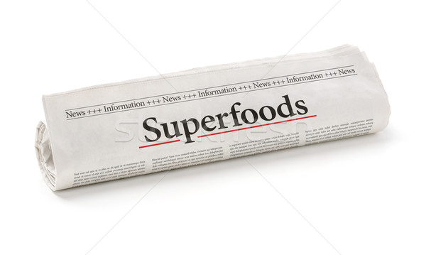 Rolled newspaper with the headline Superfoods Stock photo © Zerbor