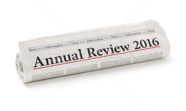 Rolled newspaper with the headline Annual review 2016 Stock photo © Zerbor