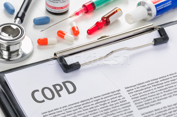 The diagnosis COPD written on a clipboard Stock photo © Zerbor