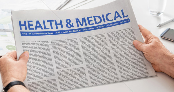 Man reading newspaper with the headline Health and Medical Stock photo © Zerbor