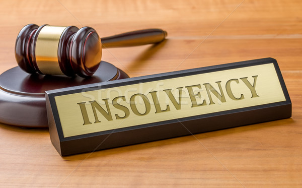 A gavel and a name plate with the engraving Insolvency Stock photo © Zerbor