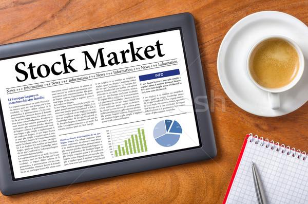 Tablet on a desk - Stock Market Stock photo © Zerbor