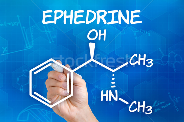 Hand with pen drawing the chemical formula of ephedrine Stock photo © Zerbor