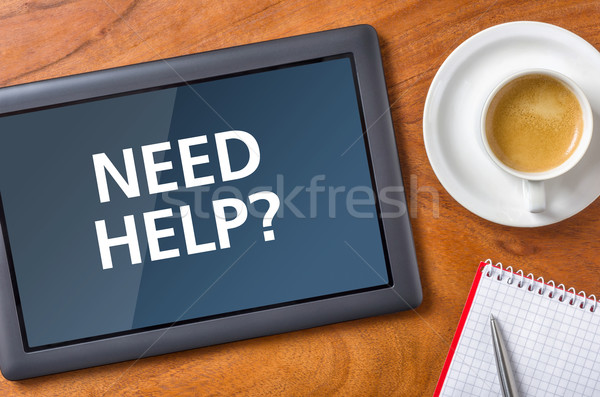Tablet on a desk - Need help Stock photo © Zerbor
