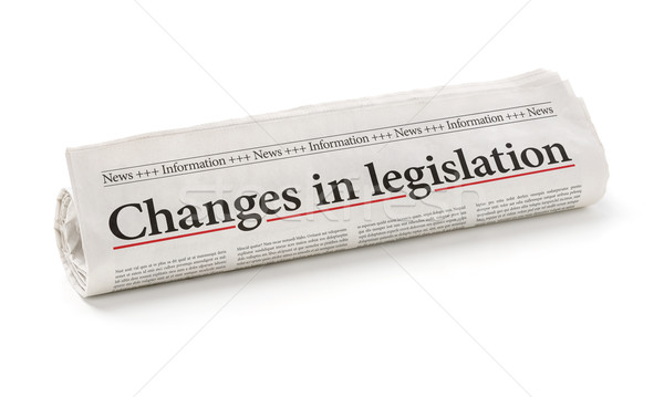 Rolled newspaper with the headline Changes in legislation Stock photo © Zerbor