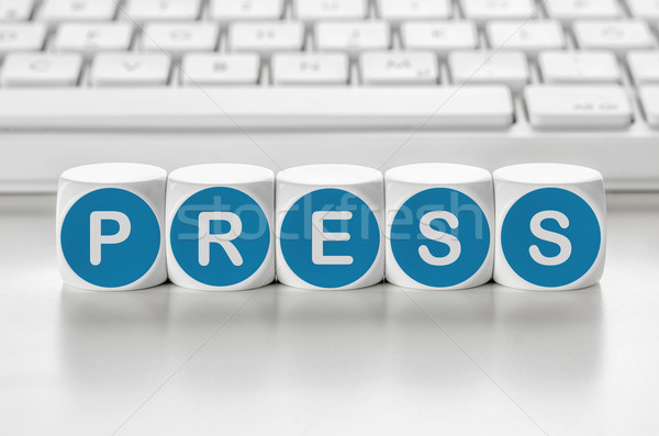 Letter dice in front of a keyboard - Press Stock photo © Zerbor