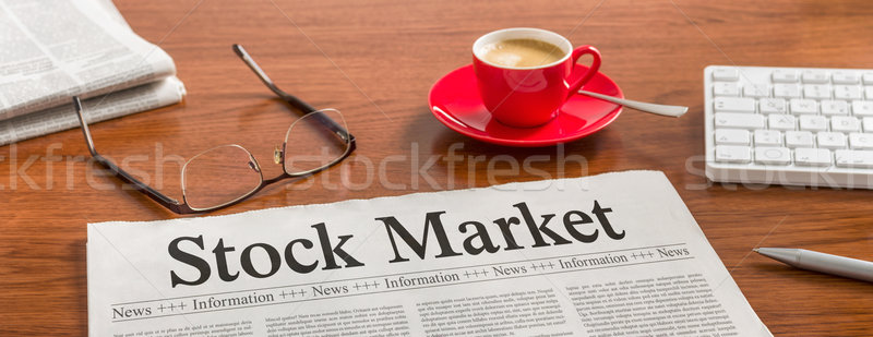 Stock photo: A newspaper on a wooden desk - Stock Market