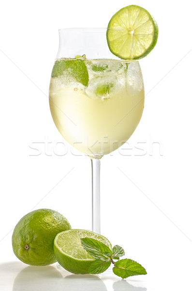 Drink with lime and mint in a wine glass Stock photo © Zerbor
