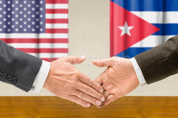 Representatives of the USA and Cuba shake hands Stock photo © Zerbor