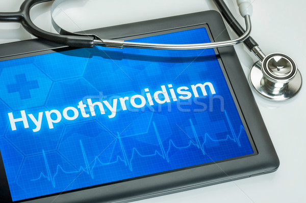 Tablet with the diagnosis Hypothyroidism on the display Stock photo © Zerbor