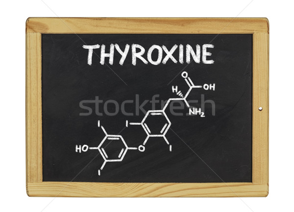 chemical formula of thyroxine on a blackboard Stock photo © Zerbor