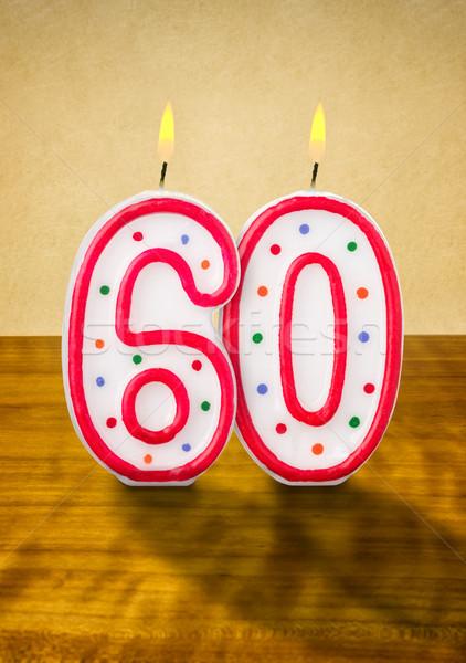 Brûlant bougies d'anniversaire nombre 60 bois signe Photo stock © Zerbor