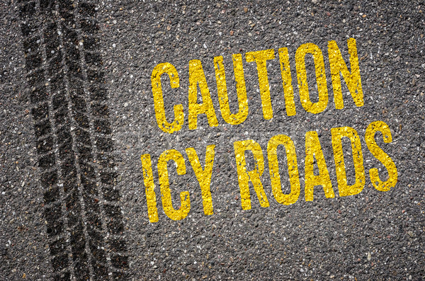 Lane with the text Caution icy roads Stock photo © Zerbor