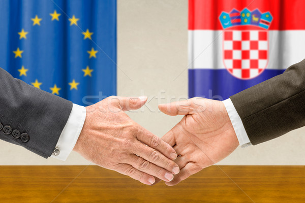Representatives of the EU and Croatia shake hands Stock photo © Zerbor