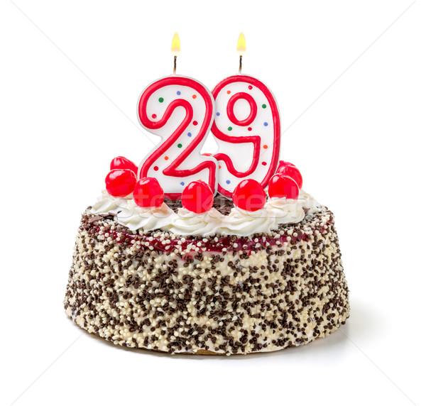 Birthday cake with burning candle number 29 Stock photo © Zerbor