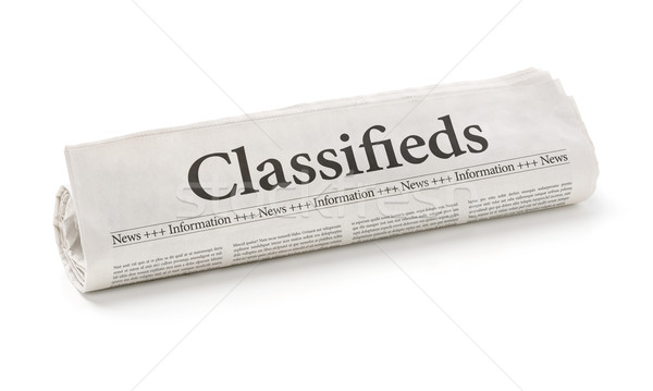 Rolled newspaper with the headline Classifieds Stock photo © Zerbor