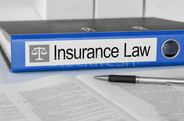 Blue folder with the label Insurance Law Stock photo © Zerbor