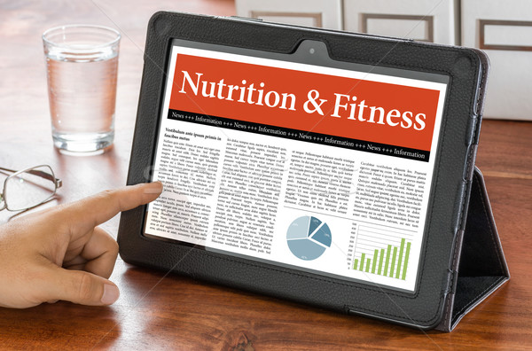 A tablet computer on a desk - Nutrition and Fitness Stock photo © Zerbor