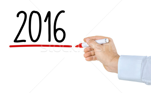 Hand with pen writing 2016 Stock photo © Zerbor