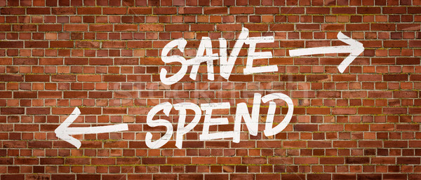 Save or Spend written on a brick wall Stock photo © Zerbor
