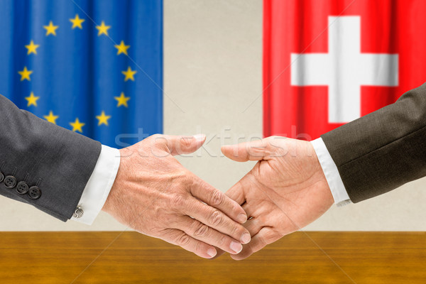 Representatives of the EU and Switzerland shake hands Stock photo © Zerbor