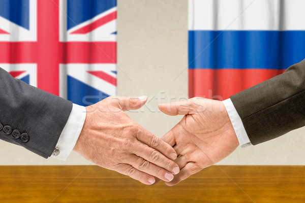 Representatives of the UK and Russia shake hands Stock photo © Zerbor