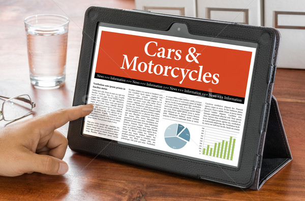 A tablet computer on a desk - Cars and Motorcycles Stock photo © Zerbor