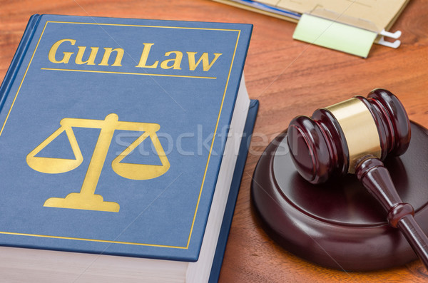 A law book with a gavel - Gun law Stock photo © Zerbor
