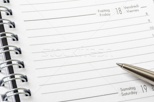 Empty planner with a pen Stock photo © Zerbor