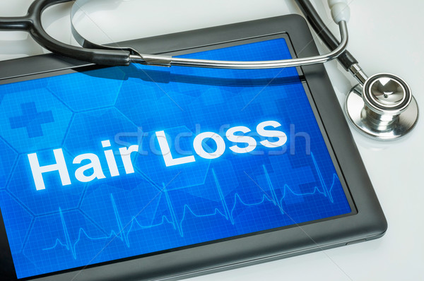 Tablet with the diagnosis Hair loss on the display Stock photo © Zerbor