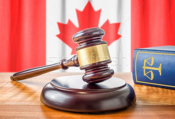 Kalapács törvény könyv Kanada zászló kalapács Stock fotó © Zerbor