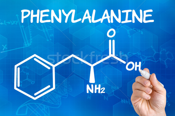 Hand with pen drawing the chemical formula of phenylalanine Stock photo © Zerbor