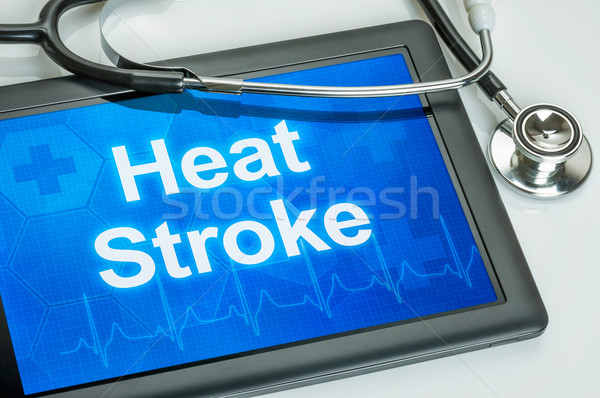 Tablet with the word Heat Stroke on the display Stock photo © Zerbor