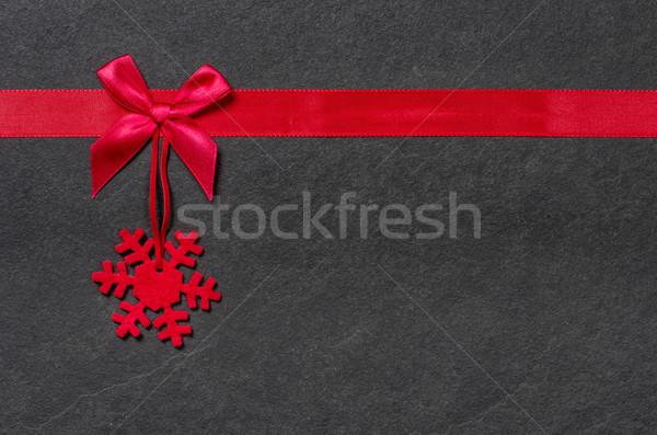 Slate board with a felt snowflake Stock photo © Zerbor