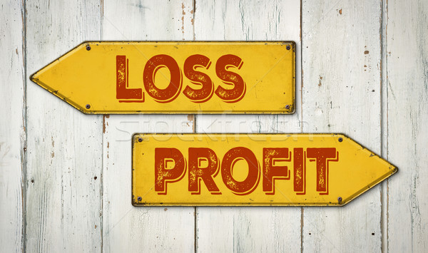 Direction signs on a wooden wall - Loss or Profit Stock photo © Zerbor