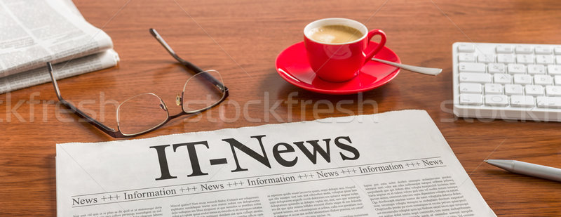 A newspaper on a wooden desk - IT-News  Stock photo © Zerbor