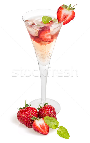 Drink with strawberries and mint in a champagne flute Stock photo © Zerbor