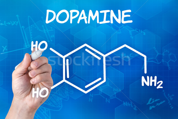 hand with pen drawing the chemical formula of Dopamine Stock photo © Zerbor