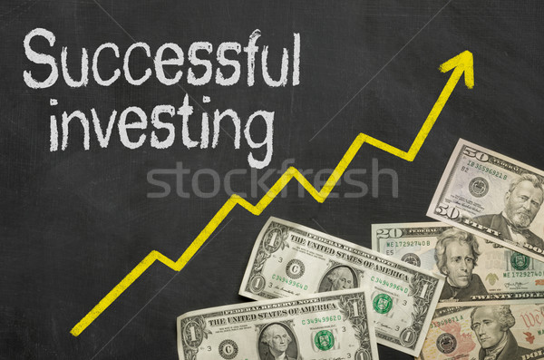 Text on blackboard with money - Successful investing Stock photo © Zerbor