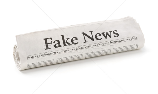 Rolled newspaper with the headline Fake News Stock photo © Zerbor