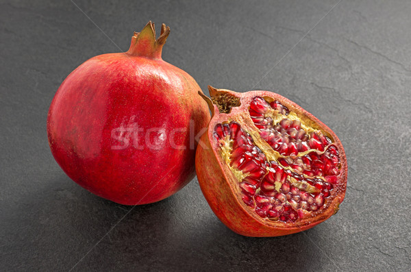 Pomegranate on a slate plate Stock photo © Zerbor