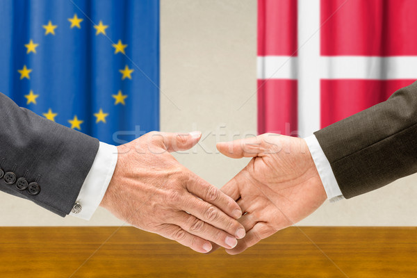 Representatives of the EU and Denmark shake hands Stock photo © Zerbor