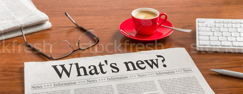 A newspaper on a wooden desk - Whats new Stock photo © Zerbor