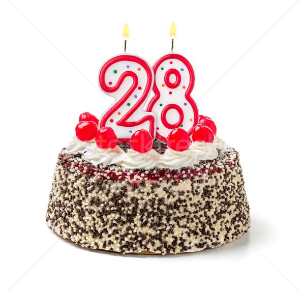 Birthday cake with burning candle number 28 Stock photo © Zerbor