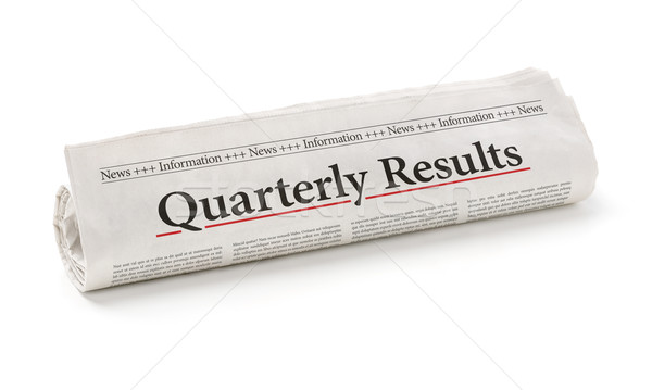 Stock photo: Rolled newspaper with the headline Quarterly Results