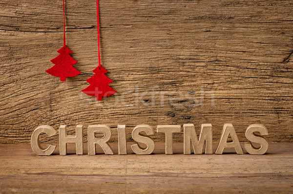 The word christmas in front of a rustic background Stock photo © Zerbor