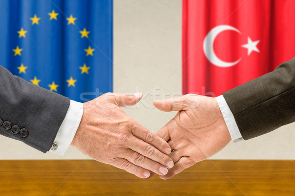 Representatives of the EU and Turkey shake hands Stock photo © Zerbor