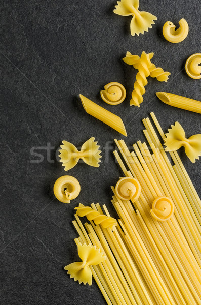 Different types of pasta on a slate background Stock photo © Zerbor