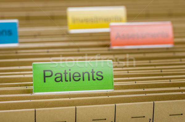Hanging file folder labeled with Patients Stock photo © Zerbor