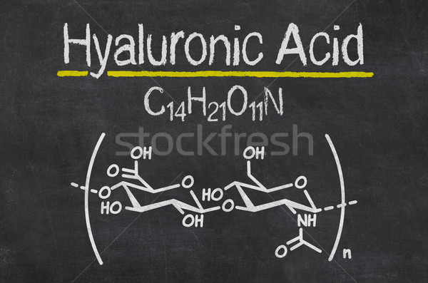 Blackboard with the chemical formula of hyaluronic acid Stock photo © Zerbor